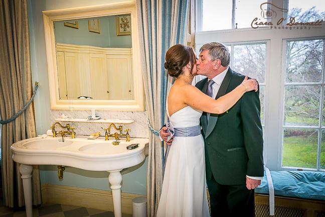 Dad kisses the bride
